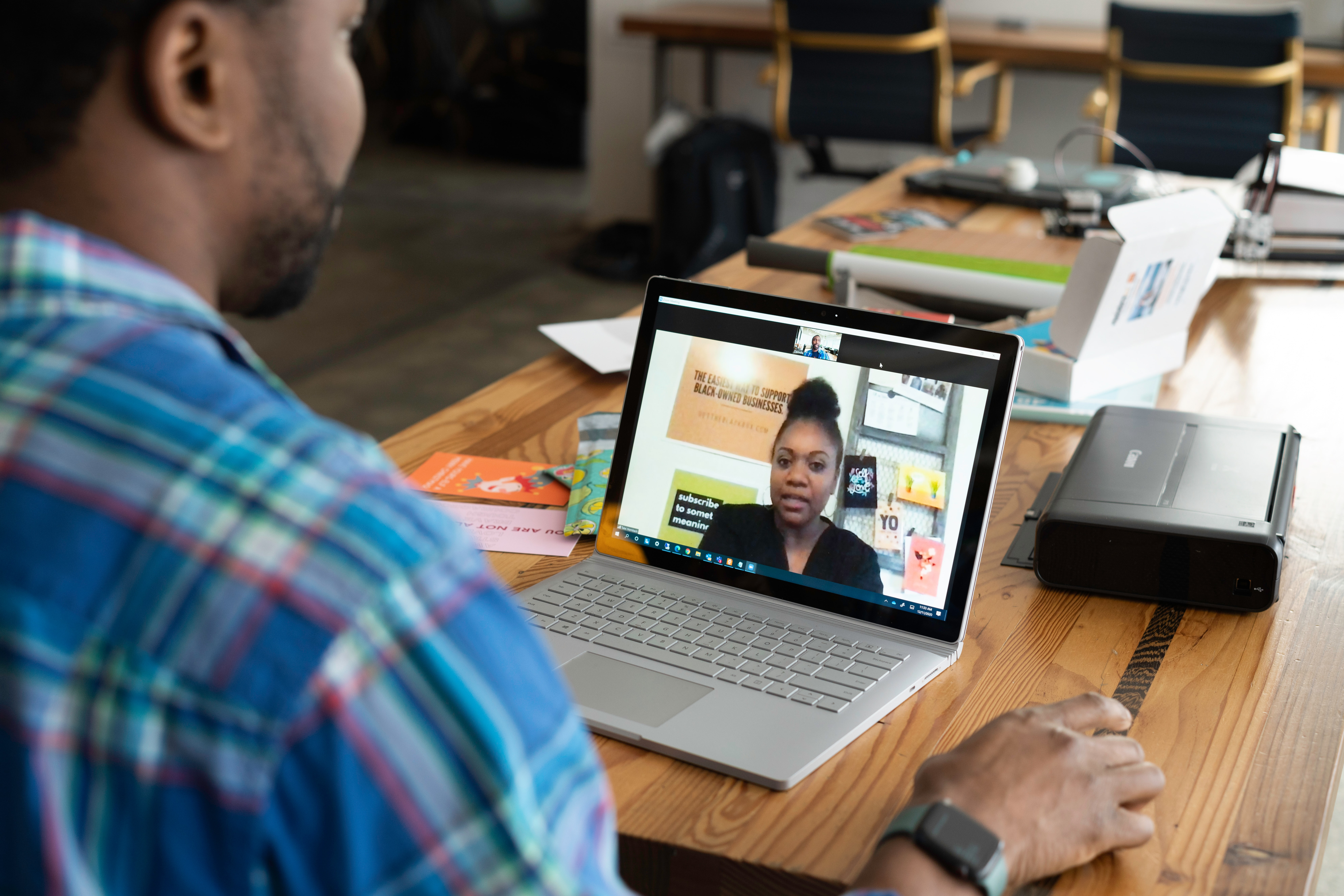 Office worker on video conference with teammate